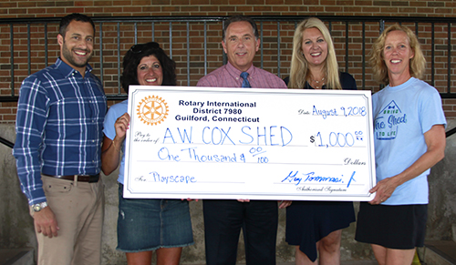 Guilford Rotary awards check to Cox School